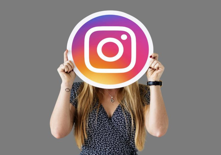 Woman showing an Instagram icon